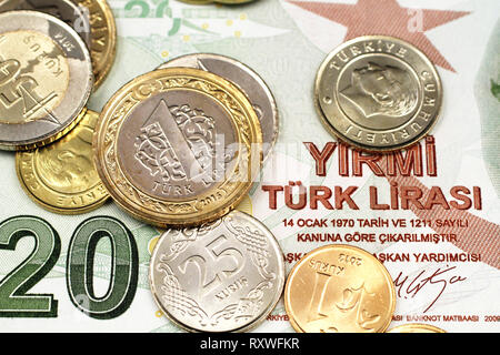 A macro image of an assortment Turkish coins close up on a red, ten Turkish lira bank note - Stock Photo