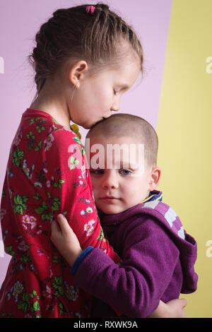 Sister consoles brother - Stock Photo