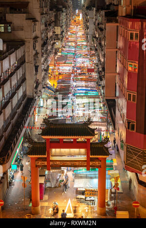 Aerial View of Temple street night flea market illumination in Kowloon Hong Kong - Stock Photo