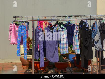 Dong Nai, Vietnam - Feb 1, 2019. Hanging clothes at the rural house in Dong Nai, Vietnam. - Stock Photo
