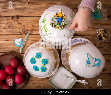 Easter cakes in the process of decorating - Stock Photo