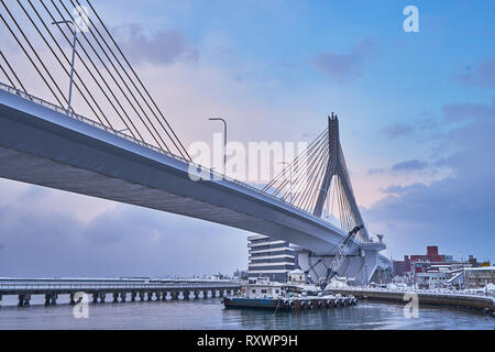 A beautiful of the longest Aomori bay bridge in Aomori prefecture in Japan. - Stock Photo