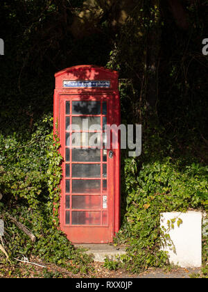 An old red telephone box in North Sands in South Devon. - Stock Photo