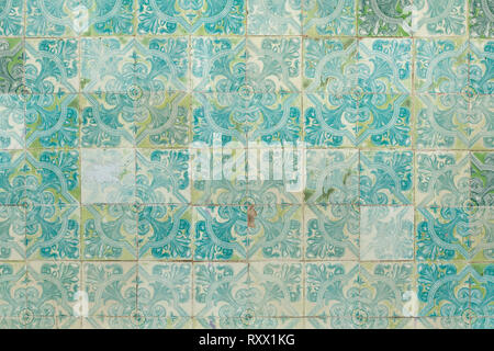 Traditional Portuguese azulejo tiles on the building in Lisbon, Portugal. Background texture. - Stock Photo