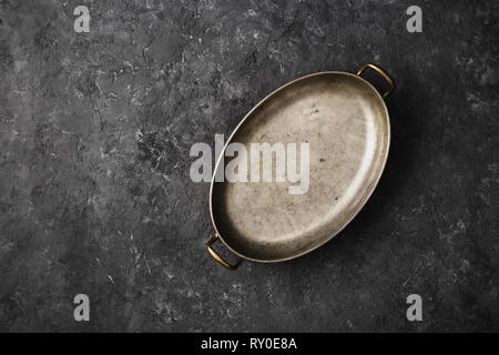 Empty old pan on dark stone background top view - Stock Photo
