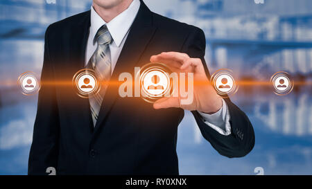 Human resource business concept. Businessman presses hr icon on virtual screen - Stock Photo