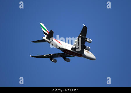 London, UK. 10th Mar, 2019. An Emirates airplane flies above The Emirates Stadium at the Arsenal v Manchester United English Premier League football match at The Emirates Stadium, London, on March 10, 2019. Credit: Paul Marriott/Alamy Live News - Stock Photo