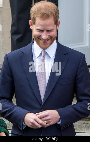LONDON, UK - March 11: Meghan Markle and Prince Harry receive flowers after leaving Canada House in London, UK Credit: Mr Pics/Alamy Live News - Stock Photo