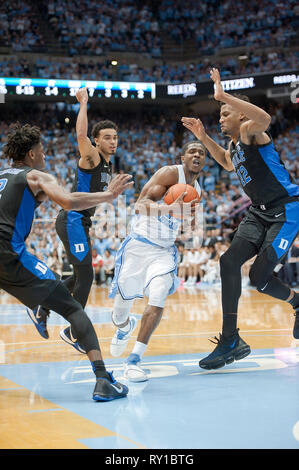 March 9, 2019 - Chapel Hill, North Carolina; USA - Carolina Tar Heels (24) KENNY WILLIAMS drives to the basket as the University of North Carolina Tar Heels defeated the Duke Blue Devils with a final score of 79-70 as they played mens college basketball at the Dean Smith Center located in Chapel Hill. Copyright 2019 Jason Moore. Credit: Jason Moore/ZUMA Wire/Alamy Live News - Stock Photo