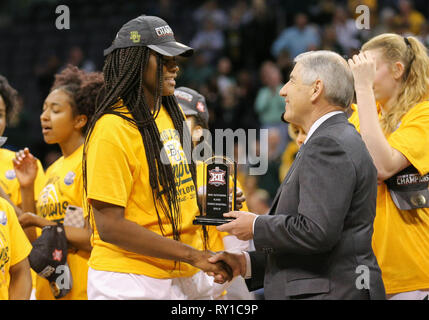 Oklahoma City, OK, USA. 11th Mar, 2019. Baylor Center Kalani Brown (21) is presented with the Most Outstanding Player for the Phillips 66 Big 12 Womens Basketball Championship Tournament at Chesapeake Energy Arena in Oklahoma City, OK. Gray Siegel/CSM/Alamy Live News - Stock Photo