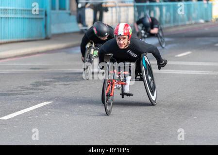 Danny Sidbury racing in the Vitality Big Half half marathon crossing Tower Bridge, London, UK. Wheelchair race - Stock Photo