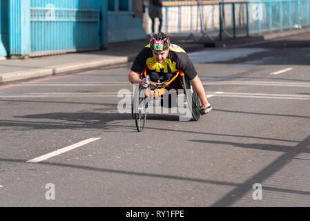 Anton Shepherd racing in the Vitality Big Half half marathon crossing Tower Bridge, London, UK. Wheelchair race - Stock Photo