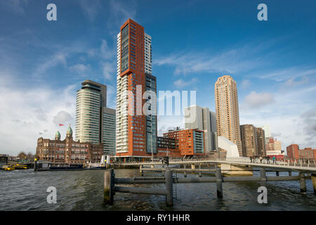 Rotterdam, The Netherlands - February 9, 2019: View from the Rijnhaven across the river Maas towards the modern skyline, a great tourist attraction in