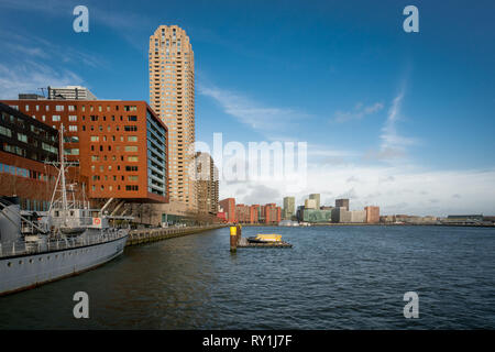 View across the Rijnhaven with New Orleans skyscraper in the foreground and the modern skyline behind.