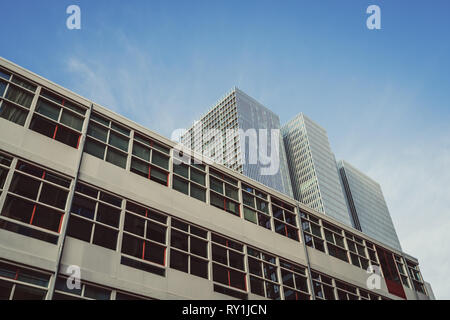 De Rotterdam, one of Rotterdam's newest skyscrapers in contrast to an older building in the foreground. - Stock Photo