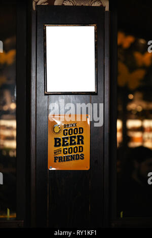 Closeup of a blank whiteboard in pub interior. Mock up, billboard, ad space frame - Stock Photo