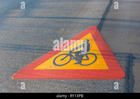 Bicycle path drawn on the asphalt road - Stock Photo