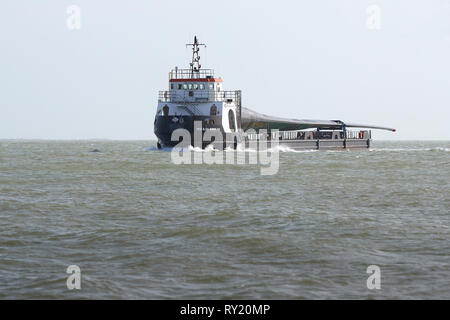 The Deck Cargo Ship, MTB BLADE RUNNER TWO, Transporting A Giant Wind Turbine Blade From The Isle Of Wight To The Port Of Southampton, UK. - Stock Photo