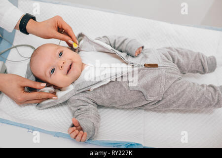Hearing Test baby , Cortical auditory evoked potential analyzer. hearing screening - Stock Photo