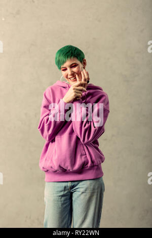 Positive nice joyful woman touching her hands - Stock Photo