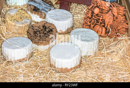 Circles of goat cheese on a peasant cart. - Stock Photo