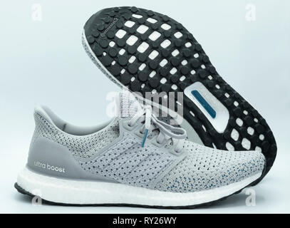 Adidas Ultraboost running shoes cut out isolated on white background - Stock Photo