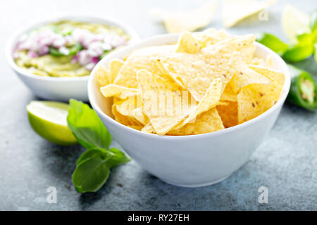 Corn chips with guacamole - Stock Photo