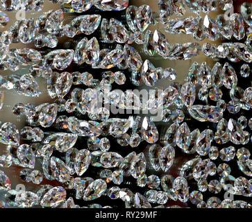 background of many diamonds symbol of luxury and wealth - Stock Photo