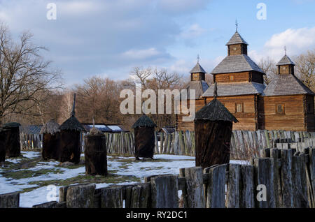 Old wooden traditional house with a straw roof in Ukrainian national museum open air Pirogovo. Kyiv, Ukraine - Stock Photo