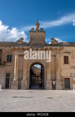 Porta San Biagio gate in Piazza di Italia square. One of the three historic gates to enter the historical center of the city. Lecce, Puglia, Italy - Stock Photo