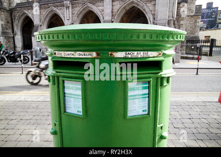 green irish double post box with the old posts and telegraphs p t logo Dublin Republic of Ireland Europe - Stock Photo