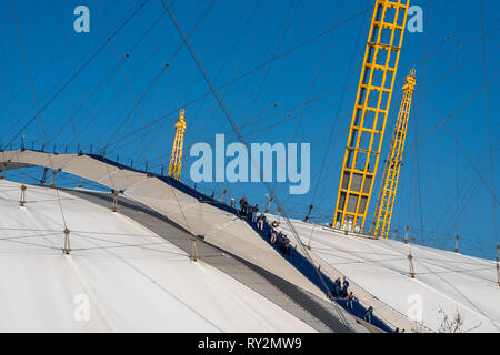 Up at the O2 arena as tourists walk over the roof - Stock Photo