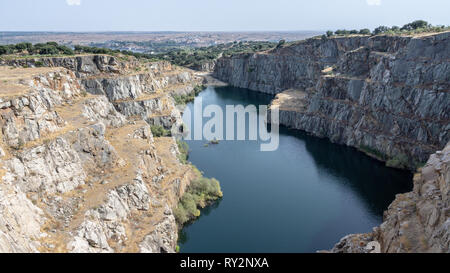 quarry open at Alcántara (Spain) with a small beach for swimming - Stock Photo