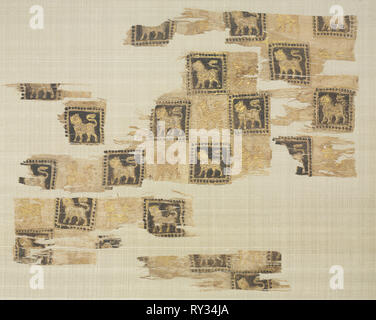 Fragment with gold leaf lions, 1000s - 1100s. Iran or Iraq, Seljuk period. Plain weave: silk warp and cotton weft (mulham); block printed and gold leaf; overall: 32.1 x 40 cm (12 5/8 x 15 3/4 in - Stock Photo