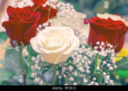 Bouquet of red and white roses. Decorative floral arrangement of white and red roses - Stock Photo