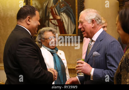 Prince of Wales (right) speaks with guests at the annual Commonwealth Day reception at Marlborough House, the home of the Commonwealth Secretariat in London. - Stock Photo