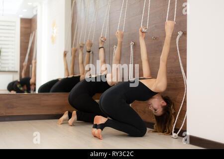 a woman practicing yoga pose iyengar yoga style stock