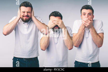 Isolated studio shot of a Caucasian woman in the See No Evil, Hear No Evil, Speak No Evil poses - Stock Photo