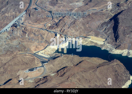 Aerial view of the Black Canyon and Hoover Dam on the Colorado River between Nevada and Arizona, USA shot from a plane window - Stock Photo