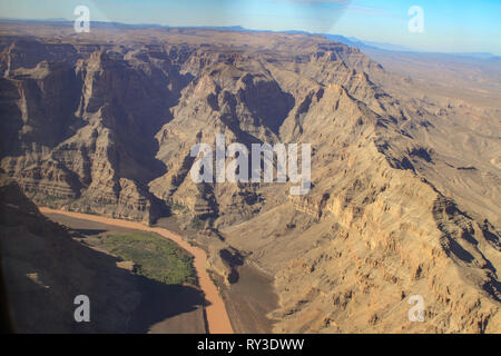 View of the Colorado River flowing through a steep rocky gorge with eroded walls in the Grand Canyon, USA - Stock Photo