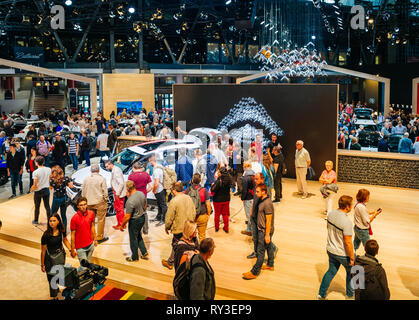 PARIS, FRANCE - OCT 4, 2018: Elevated above view of customers and curious people admiring the new Citroen cars at International car exhibition Mondial Paris Motor Show, model produced by French  car maker - Stock Photo
