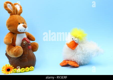 Funny Easter Composition with Teddy Bunny and Chocolate Hen - Stock Photo