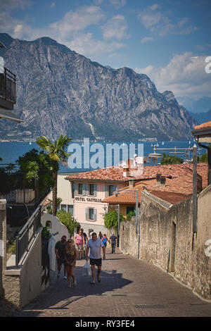 Malcesine, Italy - August, 2018. View of the Lake Garda from the town of Malcesine, in the region of Veneto in Northern Italy. - Stock Photo