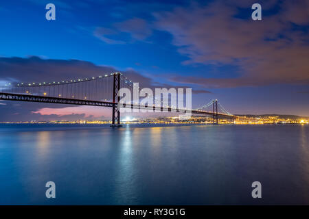 25th of April Bridge view from the south side of Tagus River, Lisboa, Portugal - Stock Photo