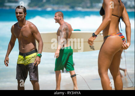 RIO DE JANEIRO - FEBRUARY 09, 2017: A surfer passes an altinho (keepie-uppies) circle at the Arpoador surf break on Ipanema Beach. - Stock Photo