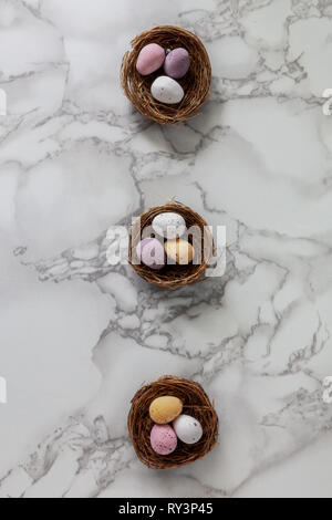 Looking down on chocolate Easter eggs laid out in nests - Stock Photo
