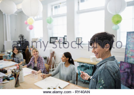 Woman leading art painting class - Stock Photo