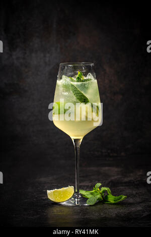 Hugo prosecco with ice and lime on black background - Stock Photo
