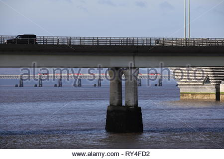 Tay Road Bridge and LNER train crossing Tay Rail Bridge Dundee Scotland  March 2019 - Stock Photo