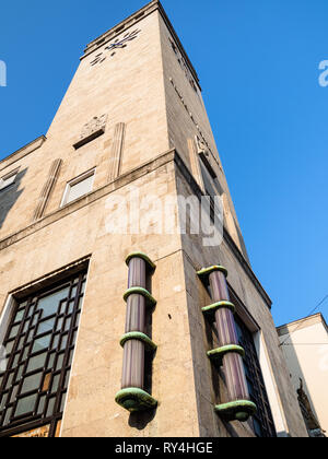 BERGAMO, ITALY - FEBRUARY 19, 2019: clock tower of Post and Telegraph palace (Palazzo delle Poste) in Bergamo city. The Post Office was commissioned i - Stock Photo